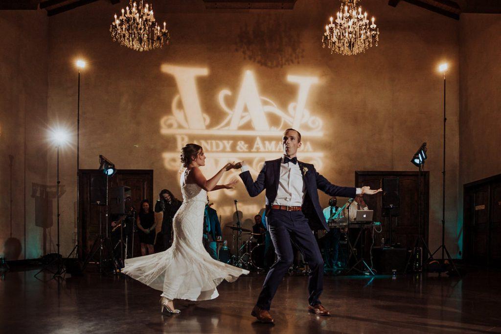 fun couple dancing at wedding
