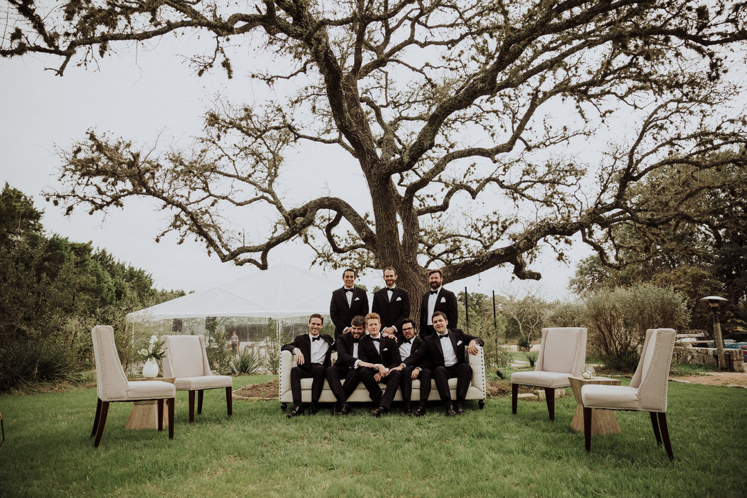 groomsmen image under a large tree