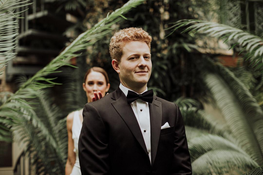 groom smiling before seeing bride