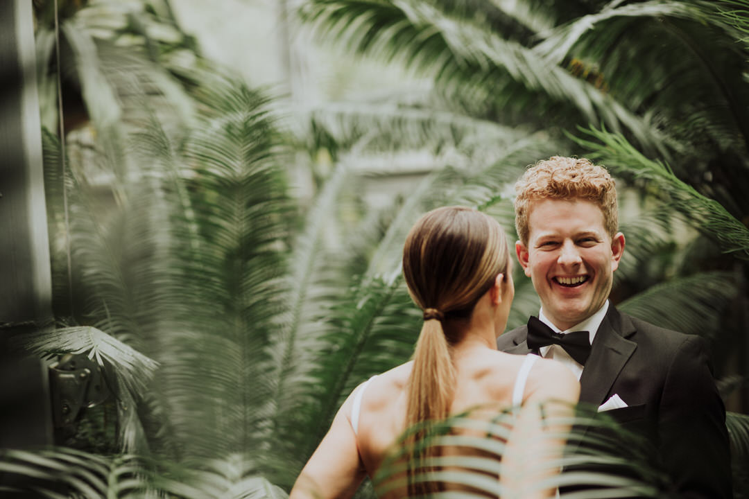 groom laughing with bride