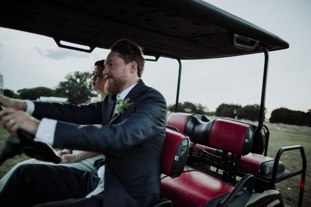 groom driving golf cart