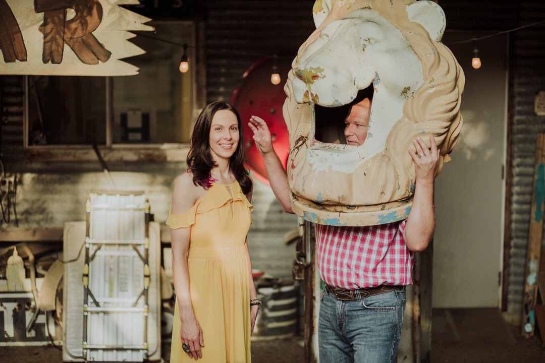 groom making bride laugh with lion head