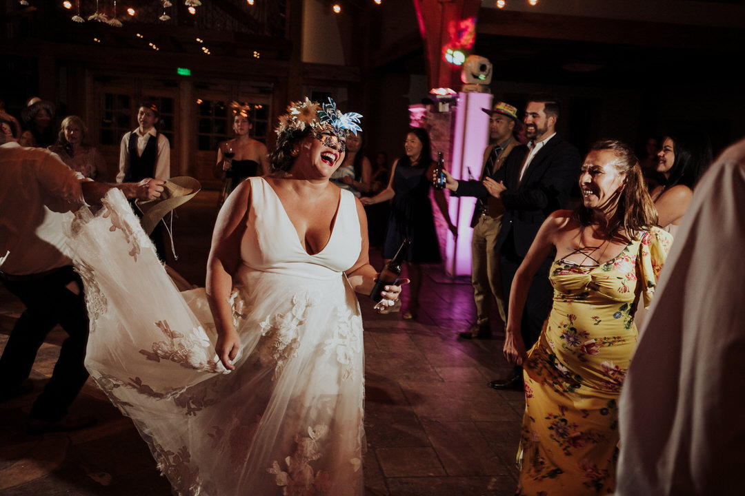 bride laughing on the dance floor