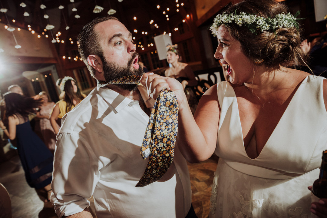 bride pulling on groom's tie