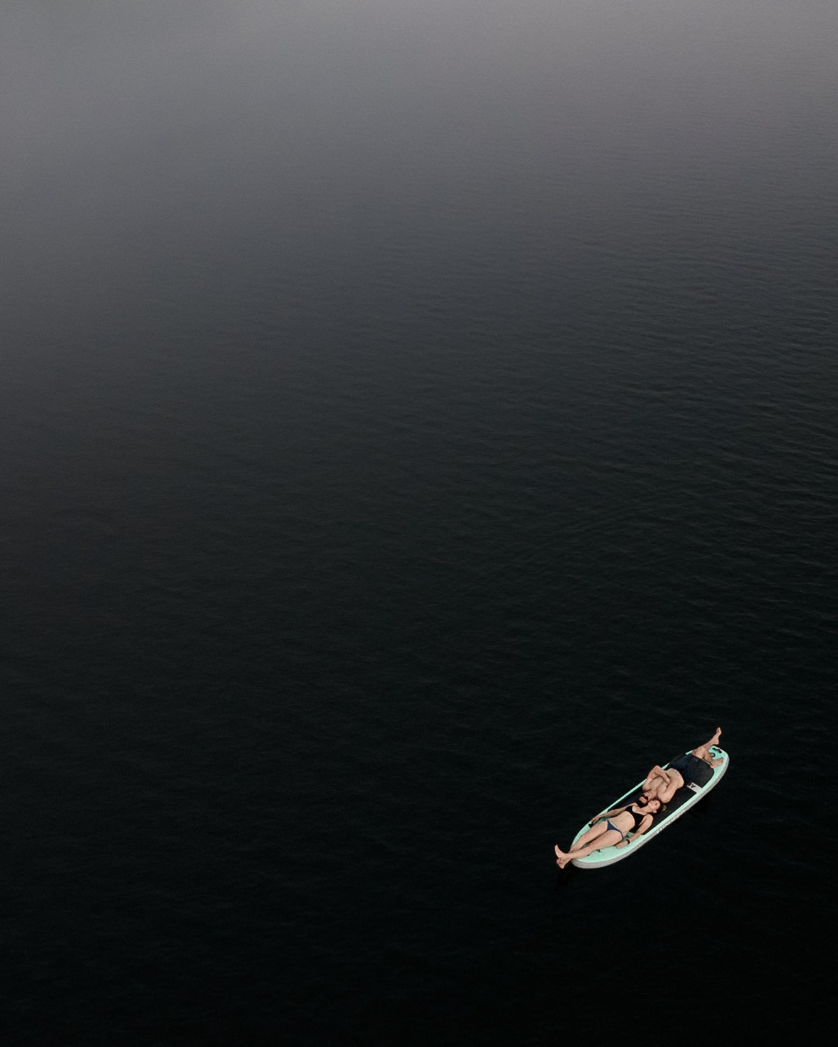 drone sup photograph of couple